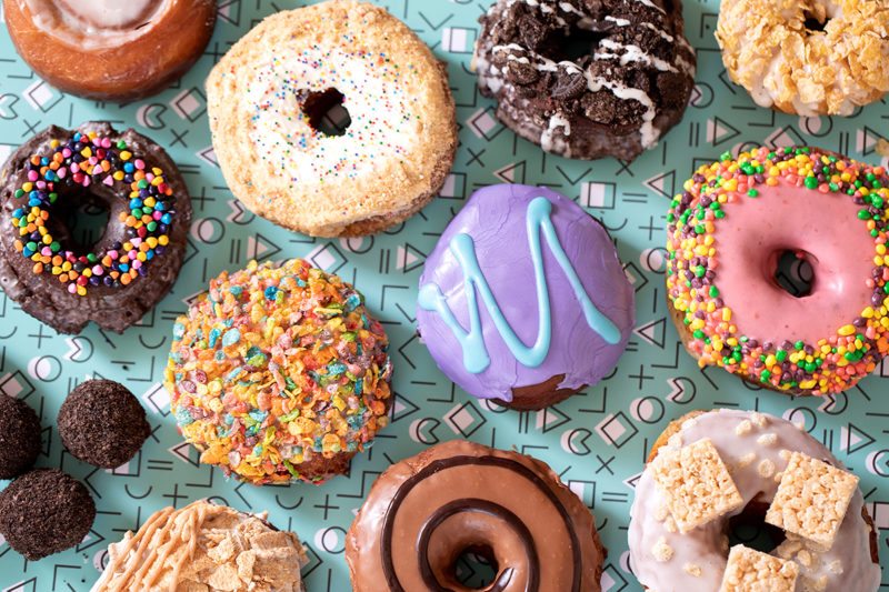 Dunkaroos, Pop Rocks, Cosmic Brownies: These were more than just snacks to young people growing up in the decade of the 1990s – they were a way of life. Much like fashion, pop culture, and so much more from the era, the nostalgia craze has hit full force when it comes to snacking. PVDonuts in Rhode Island offers a limited-time '90s-themed menu full of mouthwatering millennial favorites including the above flavors.