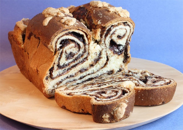 First is the babka, a spongy, sweet yeast cake. It is made from a doubled and twisted length of yeast dough and is typically baked in a high loaf pan, with cinnamon and/or chocolate in the dough.