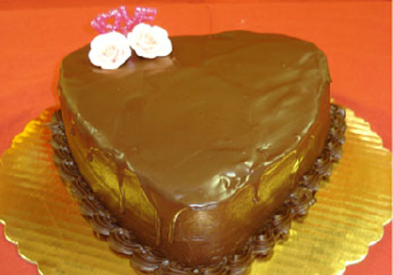 Chocolate covered heart cakes are a Valentine's special at Duke Bakery, a full-line retail bakery specializing in wedding cakes, specialty cakes, donuts, pastries, pies, bread, and cookies.