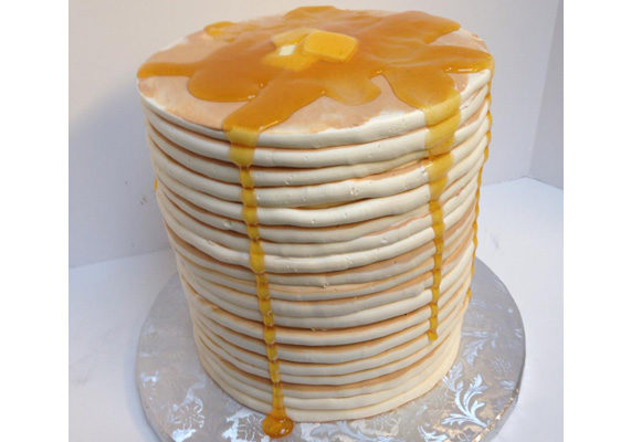 """Who says Dads can't enjoy cake for breakfast? Freeport Bakery in Sacramento, CA, just unveiled this version of a """"panCAKE"""" stack made of deliciously decorated cake layers."""
