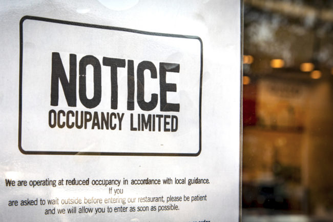 Restaurants limited occupancy due to coronavirus sign