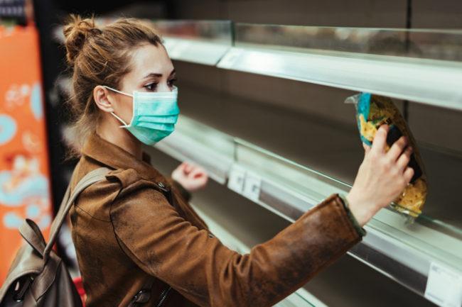Millennial woman grocery shopping during coronavirus pandemic