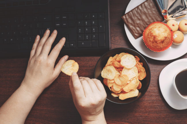 Eating snacks while using computer
